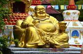 Large Golden Statue Of Seated Laughing Buddha In Wat Koh Wanararm, Langkawi Island, Malaysia. Lucky  poster