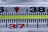 Medical Thermometer In Macro With Temperature poster