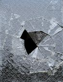 stock photo of stippling  - a piece of glass window with a cracked hole - JPG