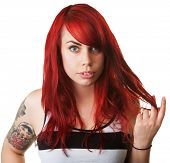 image of fidget  - Serious Caucasian woman with tattoo twirling her hair - JPG