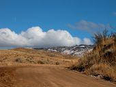 pic of boise  - A sunny day and brilliant blue skies showcase the first snowfalls in the foothills near Boise - JPG