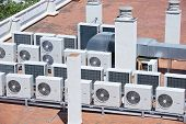 picture of air compressor  - view on the roof of a building of a large air conditioning equipment - JPG