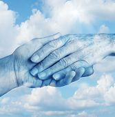 stock photo of say goodbye  - Saying goodbye mourning and grief concept with the hand of a young person letting go an elderly senior who is in the final stages of life on a sky background as a symbol of heaven and emotional feelings related to terminal patients - JPG