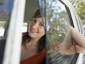 image of campervan  - Closeup portrait of happy young woman in campervan during road trip - JPG