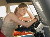picture of campervan  - Portrait of beautiful young woman sitting at driver - JPG