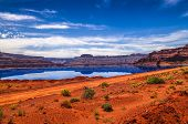 image of potash  - Evaporation Pools with La Sale Mountains in the Back against beautiful blue sky - JPG