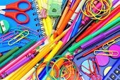 stock photo of rubber band  - Full background of a colorful assortment of school supplies - JPG
