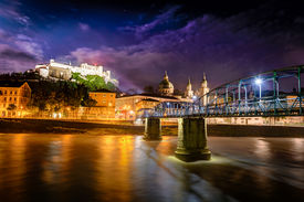 pic of mozart  - Night view of Salzburg with castle in background and Mozart bridge over Salzach river in foreground - JPG