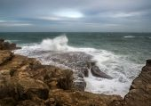 Landscape Of Waves Crashing Onto Rocks During Beautiful Winter's Day