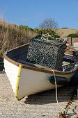 Small fishing boat with crab pot
