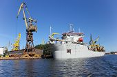 image of dredge  - Dredging ship berthed at the wharf port in Gdansk Poland - JPG