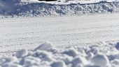 stock photo of plow  - A street recently plowed of fresh fallen snow - JPG