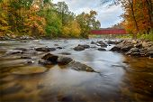 picture of covered bridge  - View of the West Cornwall Covered Bridge is a wooden lattice truss bridge built over the Housatonic River in the town of Cornwall - JPG