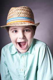 picture of spoiled brat  - close up studio portrait of a shouting boy in hat concept of spoiled child - JPG