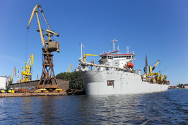 picture of dredge  - Dredging ship berthed at the wharf port in Gdansk Poland - JPG