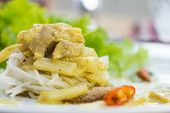 stock photo of curry chicken  - rice noodles served with Chicken Green Curry - JPG