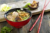 image of duck breast  - Miso soup with duck breast in red cups - JPG
