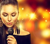stock photo of karaoke  - Beautiful Singing Girl - JPG