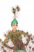 image of female peacock  - Burlesque dancer with peacock feathers and green dress in studio - JPG