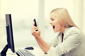 stock photo of pissed off  - picture of angry woman shouting at phone - JPG