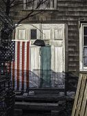 stock photo of marblehead  - A shed in a coastal town of Massachusetts proudly displaying it - JPG