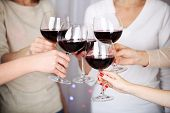 stock photo of hen party  - Woman hands with glasses of wine close - JPG