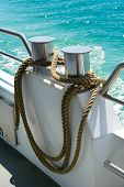 picture of bollard  - bollard with coiled rope on board ship - JPG