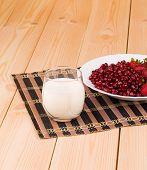 pic of wallow  - red grains of a pomegranate on the wooden background - JPG