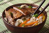 foto of chopsticks  - Asian soup with duck and rice noodle close - JPG