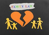 stock photo of broken hearted  - Paper family with broken heart and Family Law text - JPG
