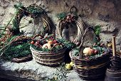 pic of greenery  - Rustic baskets filled with greenery and fruit - JPG