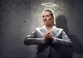image of halo  - Young saint businesswoman with halo above head - JPG