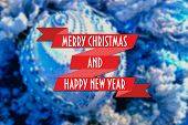 picture of blue spruce  - Merry Christmas and New Year greeting card on blurred festive decoration ball or toy and spruce blue colored background - JPG