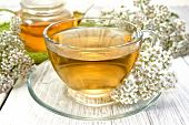 image of teapot  - Yarrow tea in a glass cup and teapot - JPG