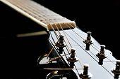 image of fret  - Details of acoustic black guitar - JPG