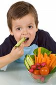 Healthy Little Boy With A Bowl Of Vegetables
