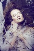 stock photo of cocoon  - beauty woman with creative make up like cocoon - JPG