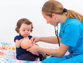 foto of baby doll  - Adorable baby examining the doll with the doctor - JPG