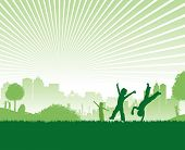 stock photo of children playing  - a green image of children playing on a cityscape background - JPG