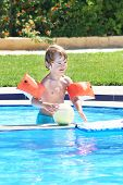 pic of pool ball  - Little Boy Playing With A Ball In A Swimming Pool - JPG