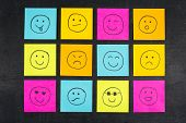 stock photo of emoticon  - Smiley colourful emoticon face sticky adhesive notes - JPG