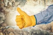 picture of credential  - Construction Engineer Wearing Yellow Leather Protective Gloves Gesturing Thumbs Up for Approval - JPG