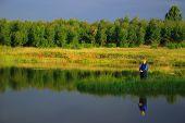 stock photo of fly rod  - Lady fly fishing - JPG