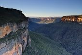 stock photo of piercings  - Pierces Pass Lookout into the Grose Valley Blue Mountains just after the sunrise - JPG