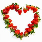 stock photo of unnatural  - Red strawberry heart shape isolated on white background symbol of love and passion - JPG