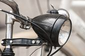 picture of headlight  - Black colored retro vintage bicycle headlight closeup - JPG