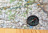 stock photo of compasses  - Geographical map and a compass - JPG