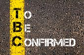 picture of confirmation  - Business Acronym TBC as To Be Confirmed. Yellow paint line on the road against asphalt background. Conceptual image - JPG