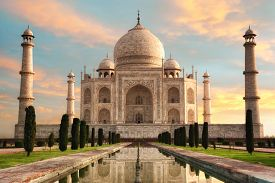 picture of glorious  - The magnificent Taj Mahal in India shows its full splendor at a glorious sunrise with pastel - JPG