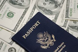 stock photo of 100 dollars dollar bill american paper money cash stack  - US Passport and pile of US dollar money - JPG